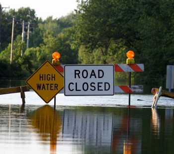 Flooded road with road closed sign