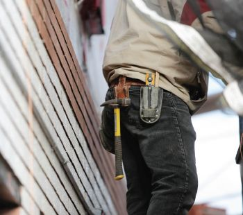 Worker wearing work pants with tools on waist